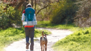 Jessica Murri hiking with her dog